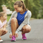 A young mom and her daughter out for a run together